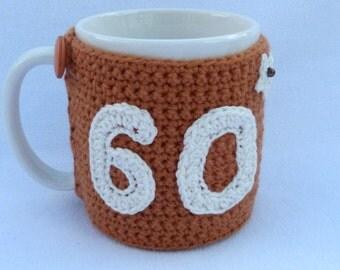 60th Birthday tan crochet mug cozy. Homewares, birthday gift, accessories, 60th gift