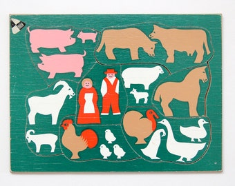 Vintage wooden jigsaw puzzle with silhouette farm animal imagery