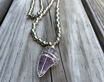 Beaded necklace with Amethyst quartz charm