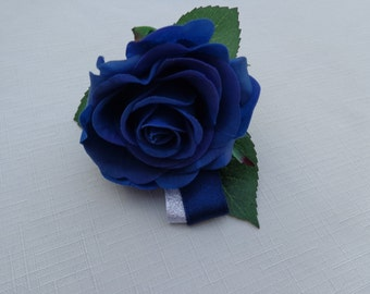 Boutonniere designed with a blue real touch rose