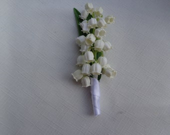 Boutonniere designed with Lily of the Valley