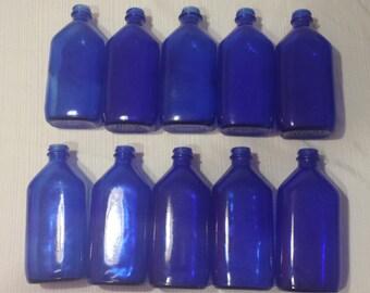 Ten Cobalt Blue Phillips Bottles