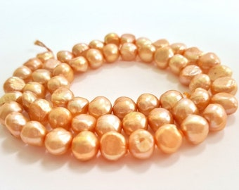Sand Colored (Light Orange/Gold) Freshwater Pearls.  8mm.  Very Pretty and Shimmery. 57 Pearls.