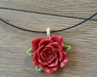 Necklace with red rose pendant