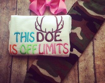This does is off limits bodysuit with camouflage leg warmers and matching pink bow