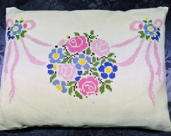Well done vintage 1950s rectangular handmade cross-stitch pastel color flower garland rosette motive embroidery on bone white linen pillow