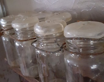 Old Glass Jars with attached Glass Lids