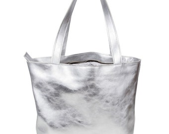 A large silver leather hobo bag