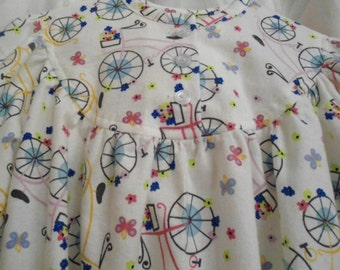 Girls Size 7 Pajamas with yellow and lilac bycles on white.