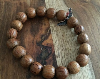 Wood Beaded Bracelet with Wing Accent