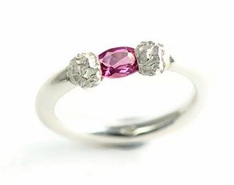 Pink tourmaline Tension-set ring design with sterling silver peppercorns an style engagement ring