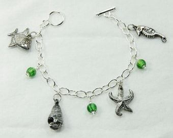 Seaside charm bracelet with green glass