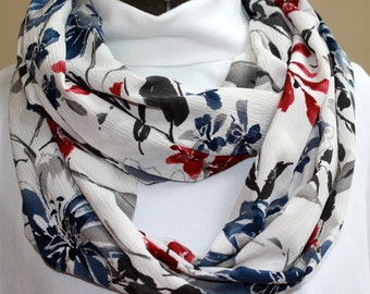 68 inch cream infinity loop scarf with blue, gray and burgundy floral print with silver glitter