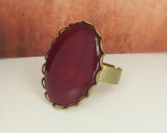 Ring adjustable bronze oval glittering dark red burgundy