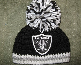 Crochet Beanie Baby Hat (Oakland Raiders colors) Embroidered Logo - Black, Gray and White with Raiders logo and large pom pom
