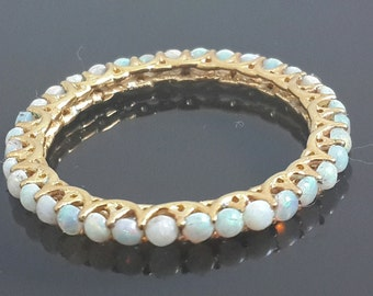 9ct yellow gold opal eternity ring