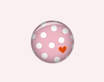 Dotted button in pink with white dots