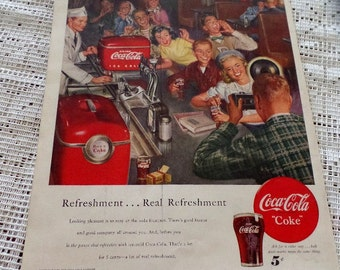 Original 1950 Coke/ Coca Cola ad.  Features a group of teens at the soda fountain.