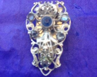 1930s Czech silvertone filigree and blue crystal dress clip