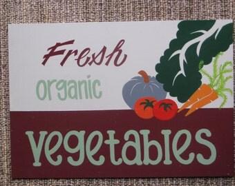Fresh organic vegetables sign