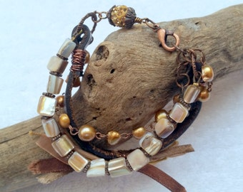 Glass beaded and leather bracelet.