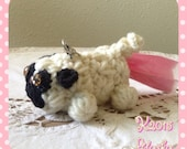 Crocheted Pug Poop Bag Holder.