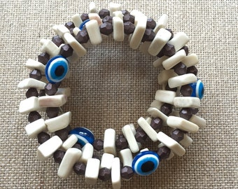THE CLARAVAL BRACELET - easy to wear.no clasp.bones.beads.blue evil eye.wrapped around.