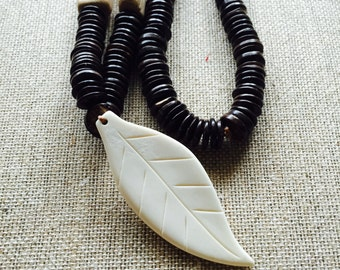 THE CAIBI NECKLACE - Beautiful.organic.handmade.coconut shells.square wood beads.bone leef pendant.
