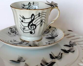 layered butterfly embellishment, 3D mini butterflies, music note paper butterflies, punched vellum butterflies