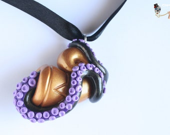 Conch necklace with tentacle.