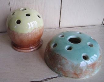 Pair of Australian pottery flower frogs