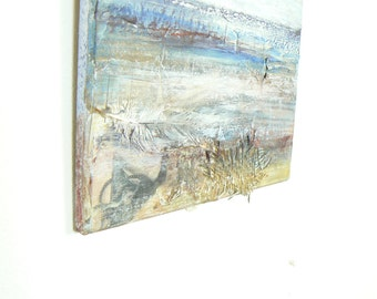 Collage style painting of the English seaside, painted on wooden board
