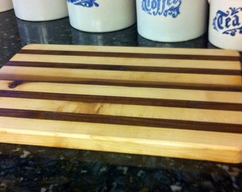 Hand crafted edge grain cutting board.  Made of maple and walnut.