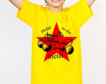 Pedal To The Metal Toy Car With Red Star Kids Ethically Produced Cotton T-Shirt  For Girls Or Boys. Yellow Green Grey Or White.. Ages 2-12*