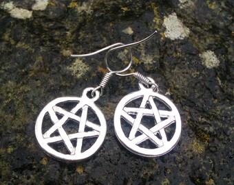Pentacle earrings - pretty pagan.