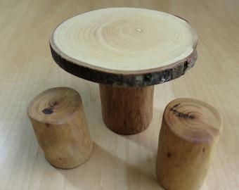 Miniature ash wood table and plum tree stump stools