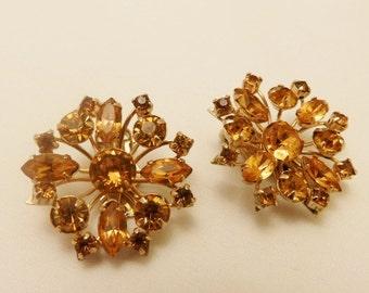 Vintage Amber Rhinestone Sunburst Clip On Earrings Signed Gale