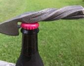 Bottle opener w/ wax cutter