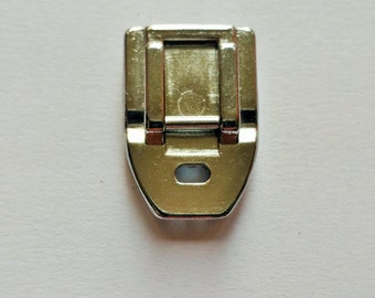 Invisible zipper presser foot for most domestic low shank sewing machines