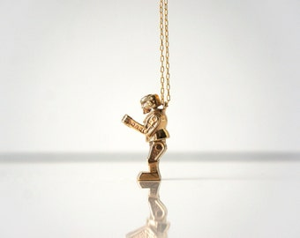 Kid at Heart - Knock'Em Dead by TO+WN DESIGN -  a necklace collection inspired by nostalgic childhood toys, gold brass