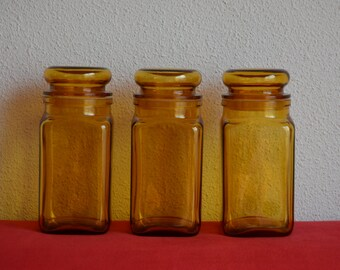Vintage square apothecary jars / containers from yellow glass with flat lids
