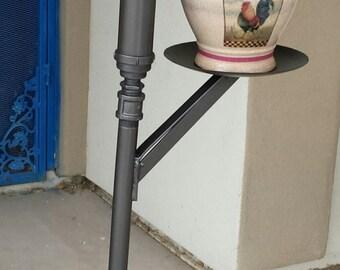 Metal garden pump plant holder