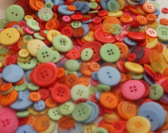 100 baby blue, pink, yellow, orange, red, green buttons, craft supplies, sewing, button arts and crafts