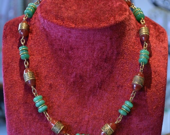 Antique green brown glass bead necklace.