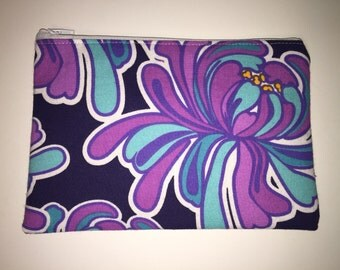 Purple and turquoise floral zippered pouch