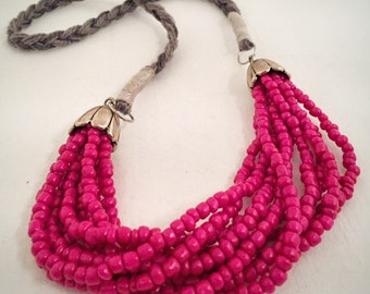 Pink beaded strand neclace with gray thread