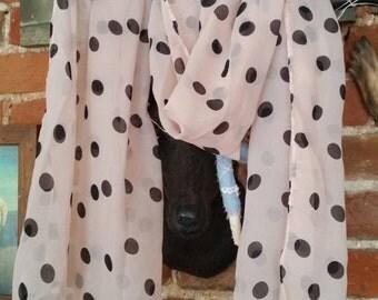 Dusky Pink and black polka-dot scarf.