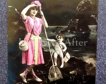 Fisher Woman Scoops out Baby // Odd RPPC surrealistic postcard, fantasy postcard // RPPC photomontage curiosity postcard enchanted lake