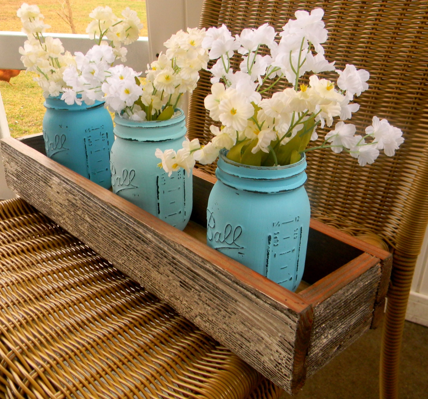 Barn wood candle box flower centerpiece by