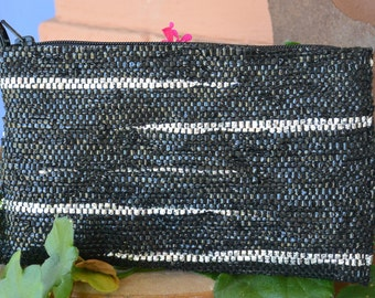 Clutch handwoven out of recycled plastic shopping bags and polypropylene